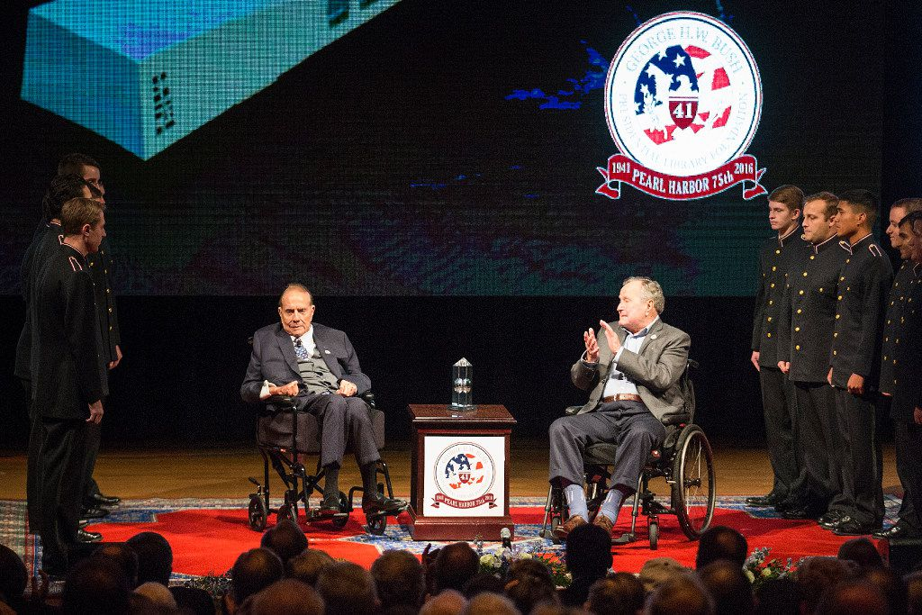 Former President George H. W. Bush applauds former Senator Bob Dole after Dole was presented with the George Bush Award for Excellence in Public Service during a 75th Anniversary of Pearl Harbor commemoration event at the George Bush Presidential Library on Wednesday, Dec. 7, 2016, in College Station, Texas. (Smiley N. Pool/The Dallas Morning News)
