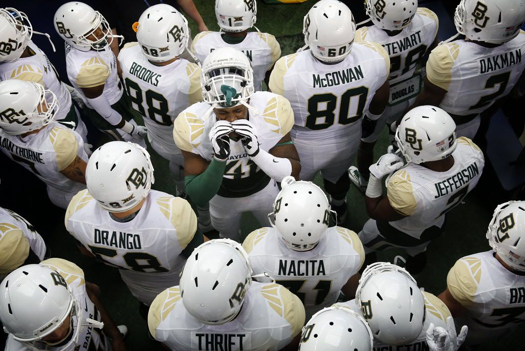 Former Baylor Bears tight end Tre'Von Armstead (41) gets his teammates fired up in the tunnel before facing  the Texas Tech Red Raiders at AT&T Stadium in Arlington, Texas, Saturday, November 29, 2014. (Tom Fox/The Dallas Morning News)