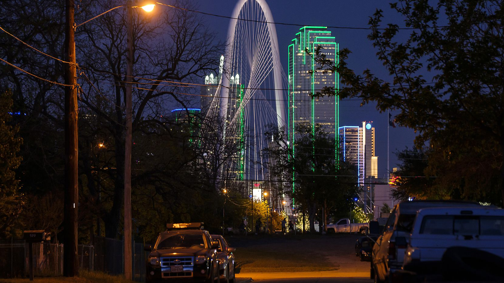 The Margaret Hunt Hill Bridge and Bank of America building highlight the downtown skyline across the river as seen looking down Toronto Street toward Bataan Street in West Dallas on Thursday, April 4, 2019.