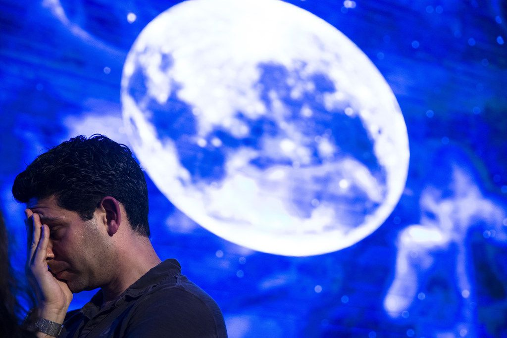 A man in Tel Aviv reacts after an Israeli spacecraft failed to land safely on the moon on April 11, 2019. The Israeli spacecraft - called Beresheet -- was a joint project between privately funded SpaceIL and Israel Aerospace Industries.