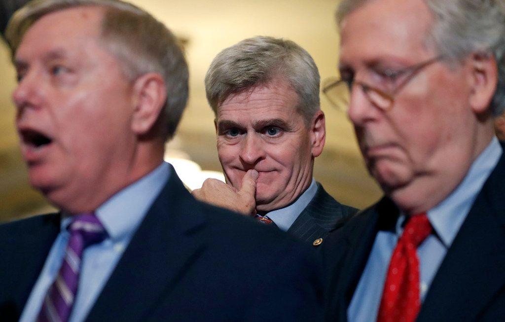 Sen. Bill Cassidy, R-La. (center) listens as Sen. Lindsey Graham, R-S.C., speaks, accompanied by Senate Majority Leader Mitch McConnell of Kentucky on Sept. 19, 2017.