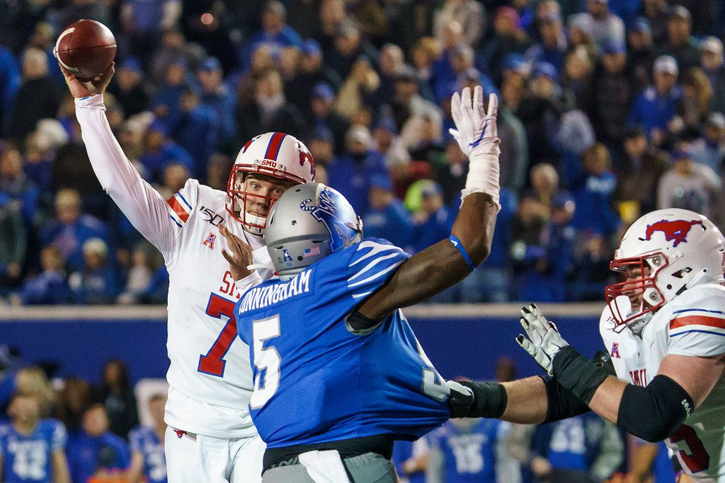 SMU quarterback Shane Buechele (7) gets off a pass under pressure from Memphis defensive end Everitt Cunningham (5) during the second half of an NCAA football game at Liberty Bowl Memorial Stadium on Saturday, Nov. 2, 2019, in Memphis, Tenn. (Smiley N. Pool/The Dallas Morning News)