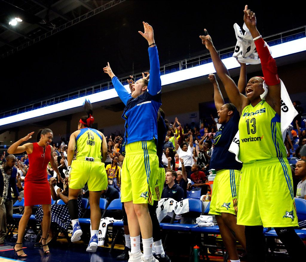 The bench reacts as the score is tied during the second half of a WNBA basketball game between Dallas Wings and the Los Angeles Sparks in Arlington, Texas, Friday, June 9, 2017. (Tailyr Irvine/The Dallas Morning News)