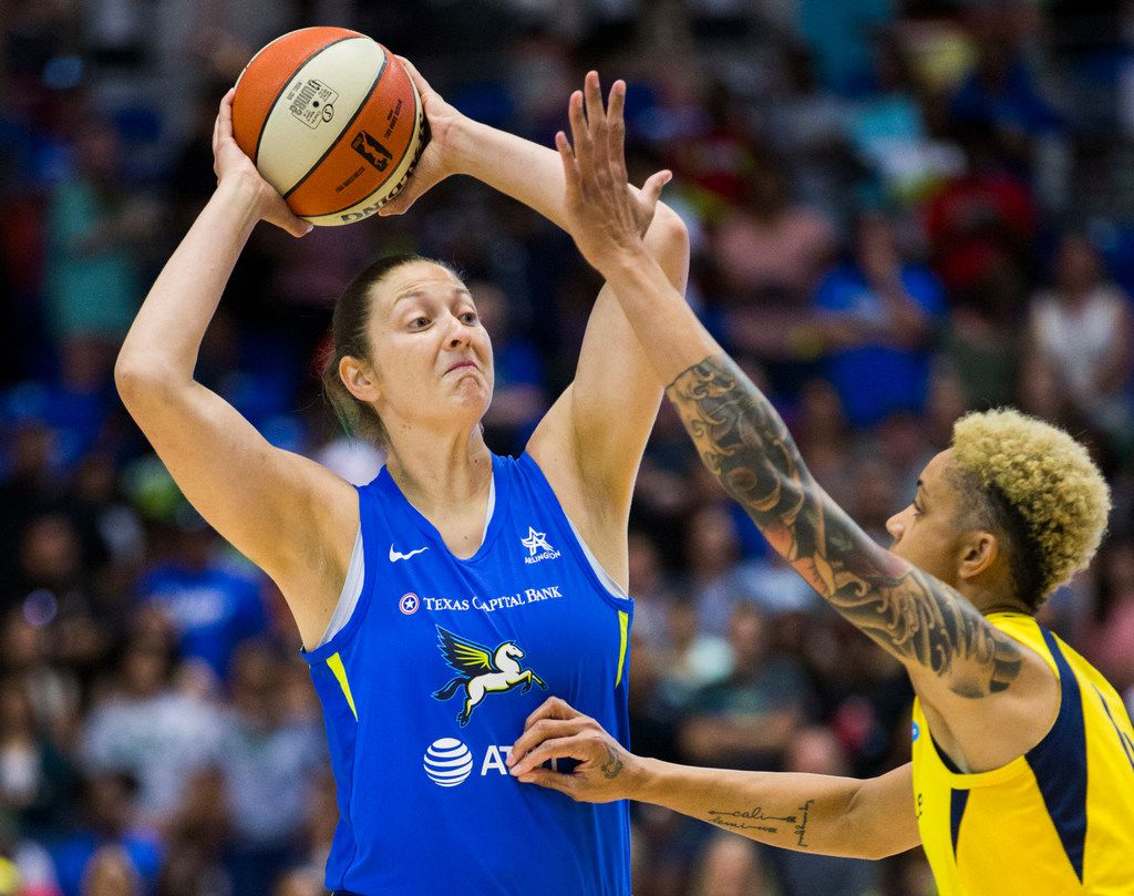 Dallas Wings forward Theresa Plaisance (55) looks for a pass over Indiana Fever forward Candice Dupree (4) during the first quarter of a WNBA game between the Dallas Wings and the Indiana Fever on Friday, July 5, 2019 at UTA's College Park Center in Arlington. (Ashley Landis/The Dallas Morning News)