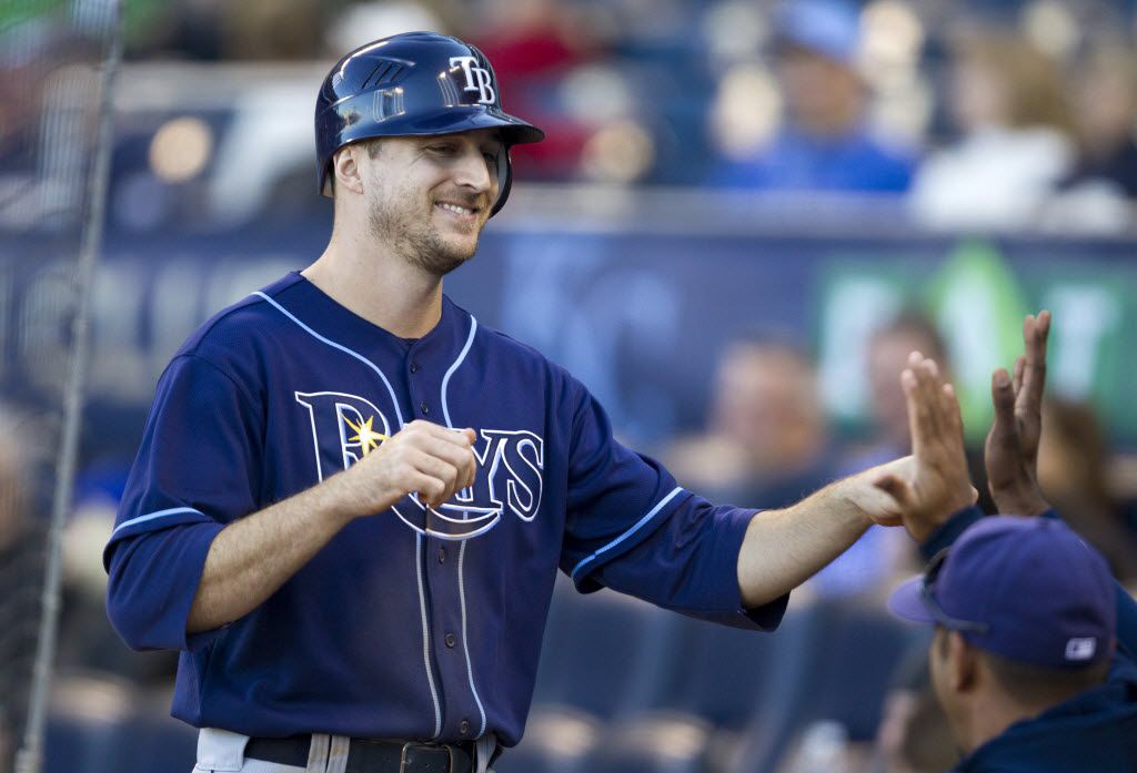 ORG XMIT: 1095100 Tampa Bay Rays' Rocco Baldelli (5) is congratulated in the dugout after scoring the winning run with a hit by Kelly Shoppach in the 12th inning in their 3-2 win over the Kansas City Royals at Kauffman Stadium in Kansas City, Missouri, on Sunday, October 3, 2010. (John Sleezer/Kansas City Star/MCT)