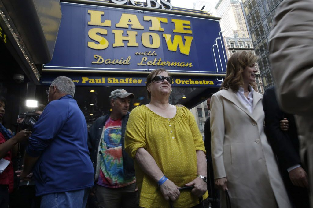 """Audience members leave the final taping of the """"Late Show with David Letterman"""" at the Ed Sullivan Theater in New York, Wednesday, May 20, 2015."""