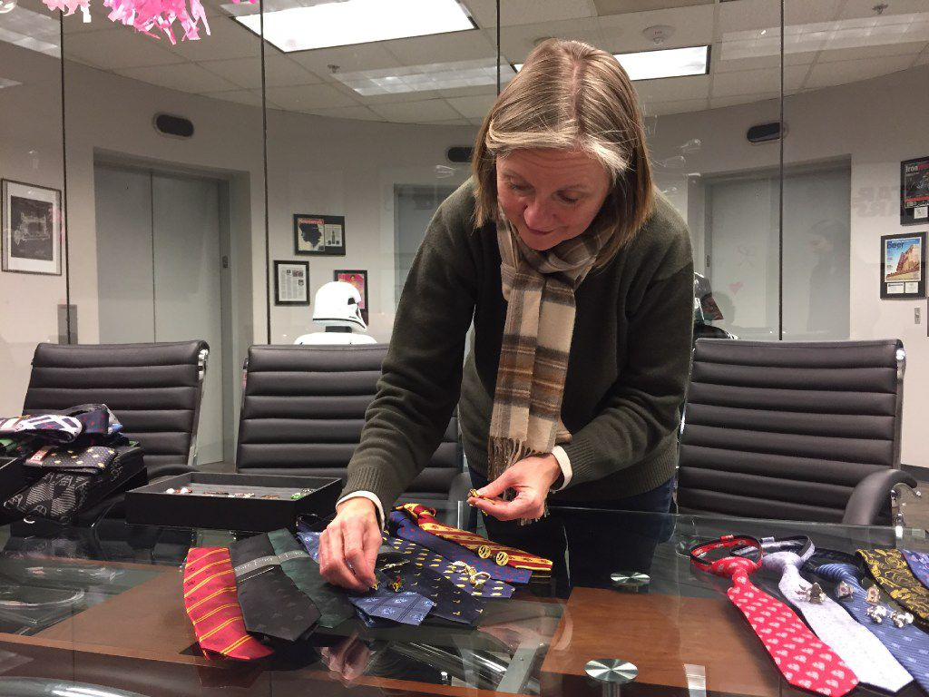 Cufflinks Inc. co-president Patty Bentley arranges Harry Potter men's and boy's accessories at the company's headquarters in Dallas. These ties and cufflinks came out for the 2016 release of the Fantastic Beasts and Where to Find Them.