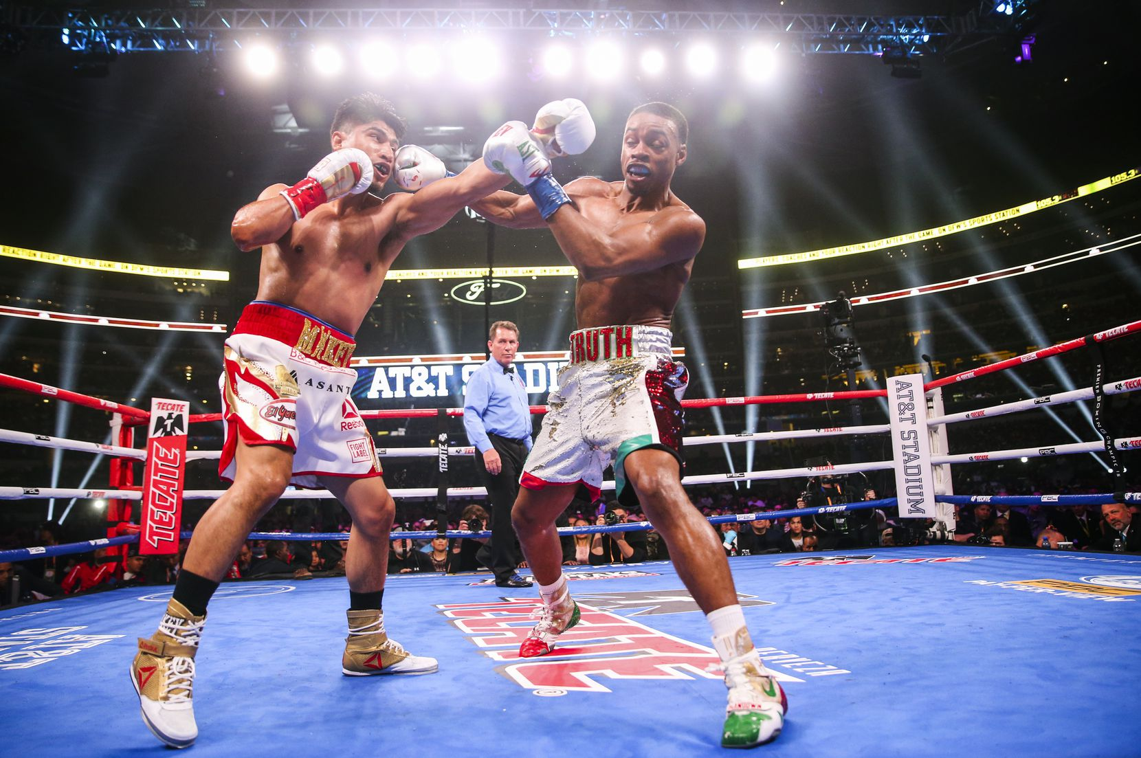 Mikey Garcia and Errol Spence Jr. box during the first round of a IBF World Welterweight Championship match on March 16, 2019, at AT&T Stadium in Arlington.