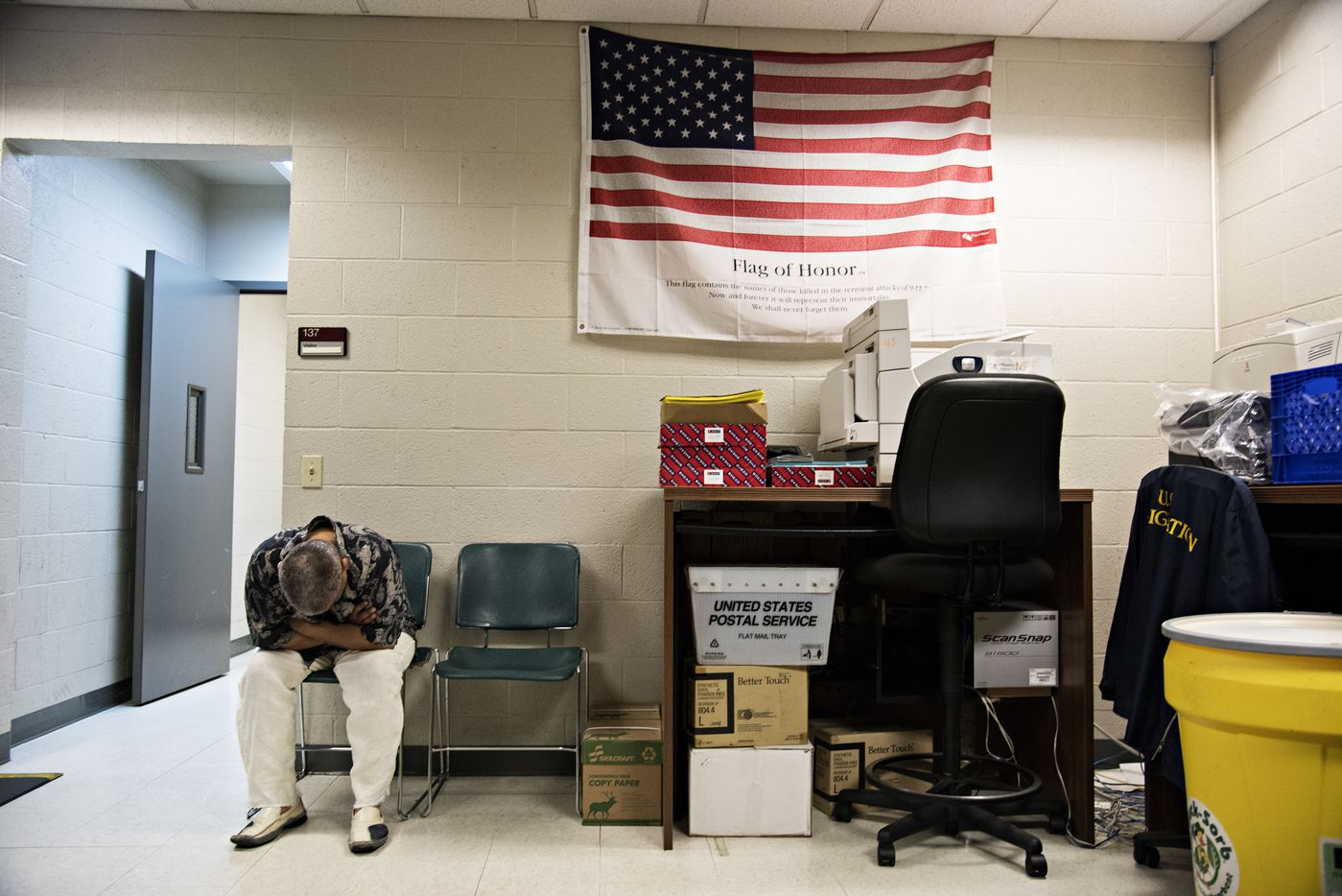 A man arrested by Immigration and Customs Enforcement agents waits to be processed at their field office in Riverside, Calif., June 22, 2017.