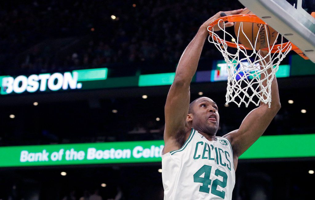 FILE - In this Oct. 30, 2018, file photo, Boston Celtics center Al Horford (42) dunks the ball against the Detroit Pistons during the first half of an NBA basketball game, in Boston. (AP Photo/Mary Schwalm, File)