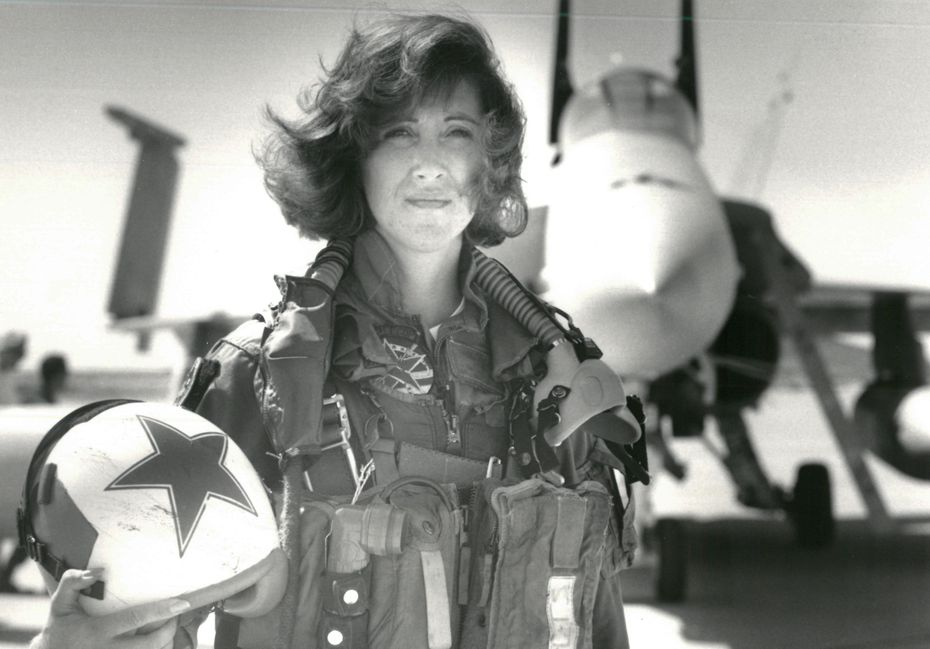 In a photo provided by the U.S. Navy, Lt. Tammie Jo Shults with her F/A-18A jet in 1992. Shults, one of the Navy's first female fighter pilots, was in command of Southwest Airlines Flight 1380 when its engine exploded on April 17, 2018; for the next 40 minutes, she maneuvered the plane safely to an emergency landing in Philadelphia.