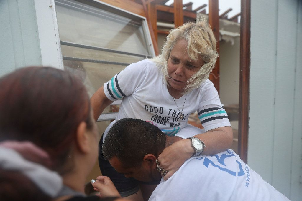 Donna Raney is helped out of the window by Lee Guerrero and Daisy Graham after Hurricane Harvey destroyed her apartment on August 26, 2017 in Rockport, Texas. Donna was hiding in the shower after the roof blew off and the walls of her home caved in by the winds of  Hurricane Harvey. Harvey made landfall shortly after 11 p.m. Friday, just north of Port Aransas as a Category 4 storm and is being reported as the strongest hurricane to hit the United States since Wilma in 2005. Forecasts call for as much as 30 inches of rain to fall by next Wednesday.