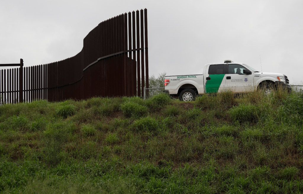 A U.S. Customs and Border Patrol agent passes along a section of border wall in Hidalgo, Texas. (AP Photo/Eric Gay, File)