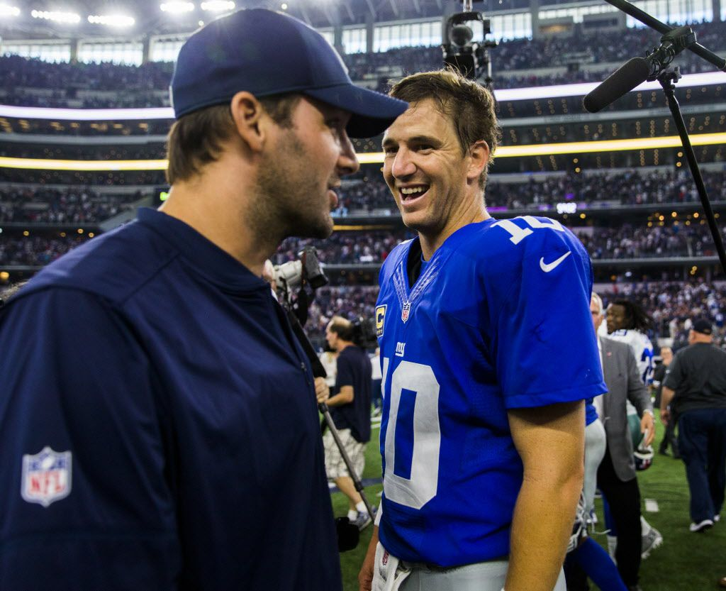 Dallas Cowboys quarterback Tony Romo (9) talks to New York Giants quarterback Eli Manning (10) after a 20-19 loss to the New York Giants on Sunday, September 11, 2016 at AT&T Stadium in Arlington, Texas. (Ashley Landis/The Dallas Morning News)