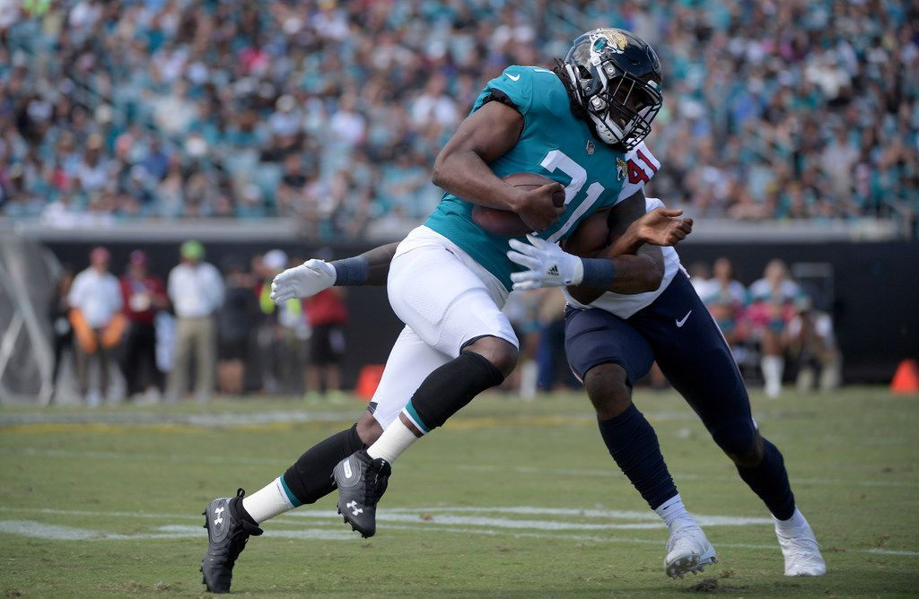 Jacksonville Jaguars running back Jamaal Charles (31) is tackled by Houston Texans linebacker Zach Cunningham (41) after catching a pass during the second half of an NFL football game Sunday, Oct. 21, 2018, in Jacksonville, Fla. The Texans won 20-7. (AP Photo/Phelan M. Ebenhack)