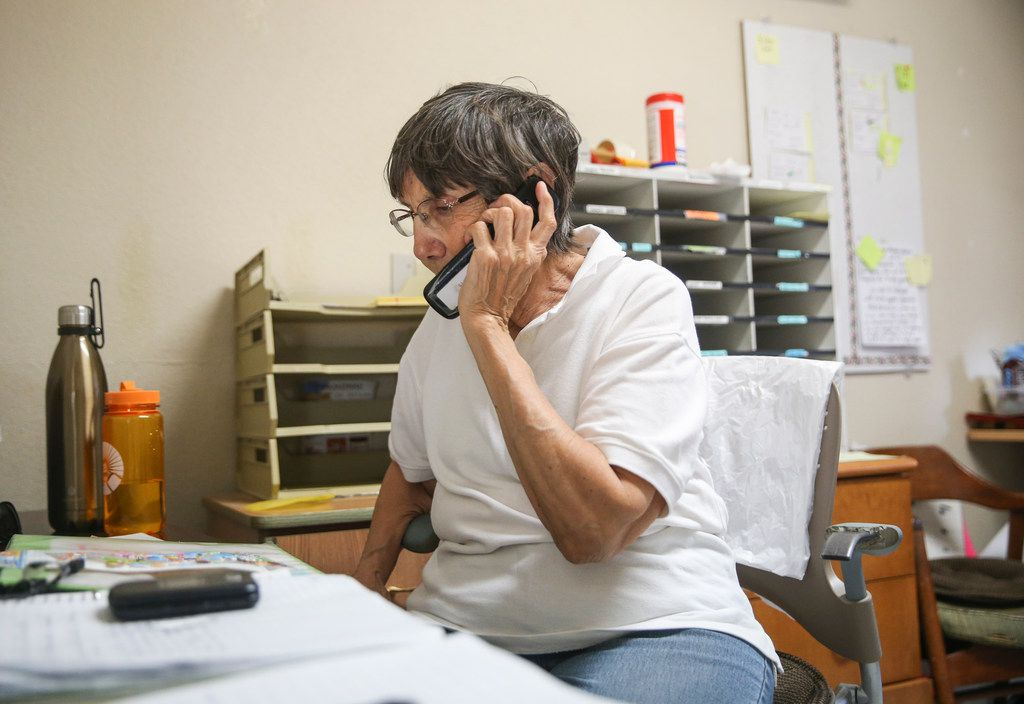 """Volunteer Sylvia Searfoss makes calls to bus companies to schedule transportation and tickets for migrants seeking asylum housed at a shelter operated by Annunciation House, an El Paso nonprofit organization that has sheltered migrants for more than 40 years, on Friday, March 29, 2019 in El Paso, Texas. """"I make all the calls, schedule the tickets,"""" Searfoss said. """"Whether that's Dallas, Houston, Orlando, wherever, I make sure they all get to the various places they're headed."""""""