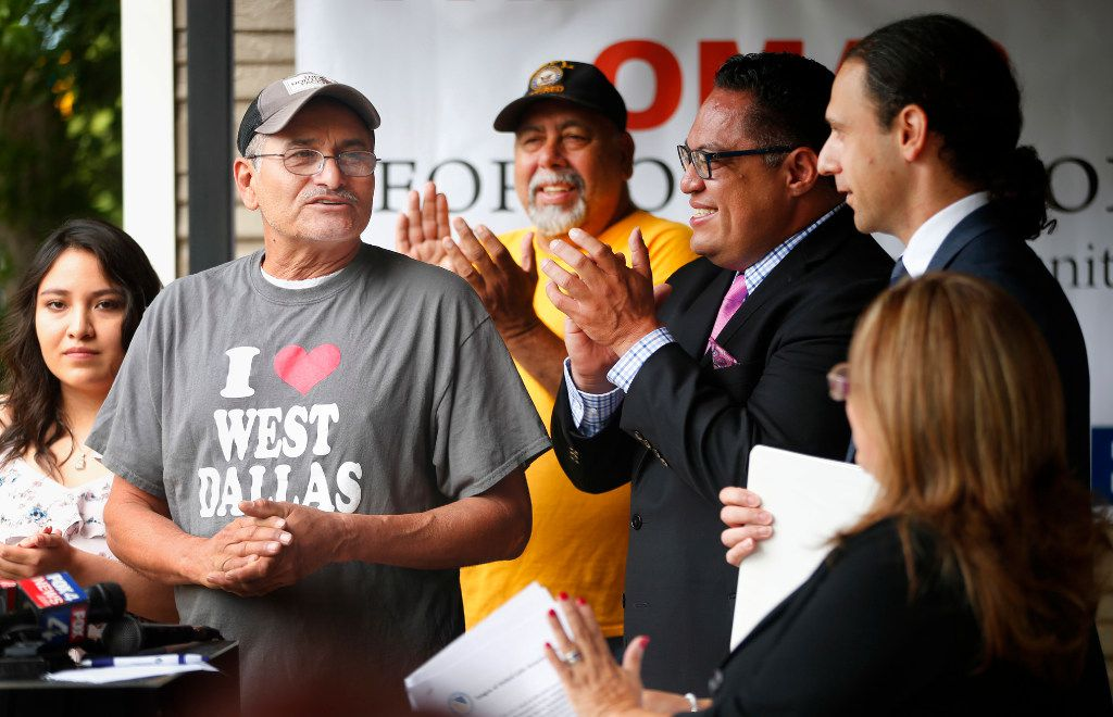 New homeowner Mercel Correa (left) praises HMK landlord Khraish Khraish (right) for allowing him to buy his home after renting the past 27 years, during a press conference on his front porch, Monday, May 22, 2017.