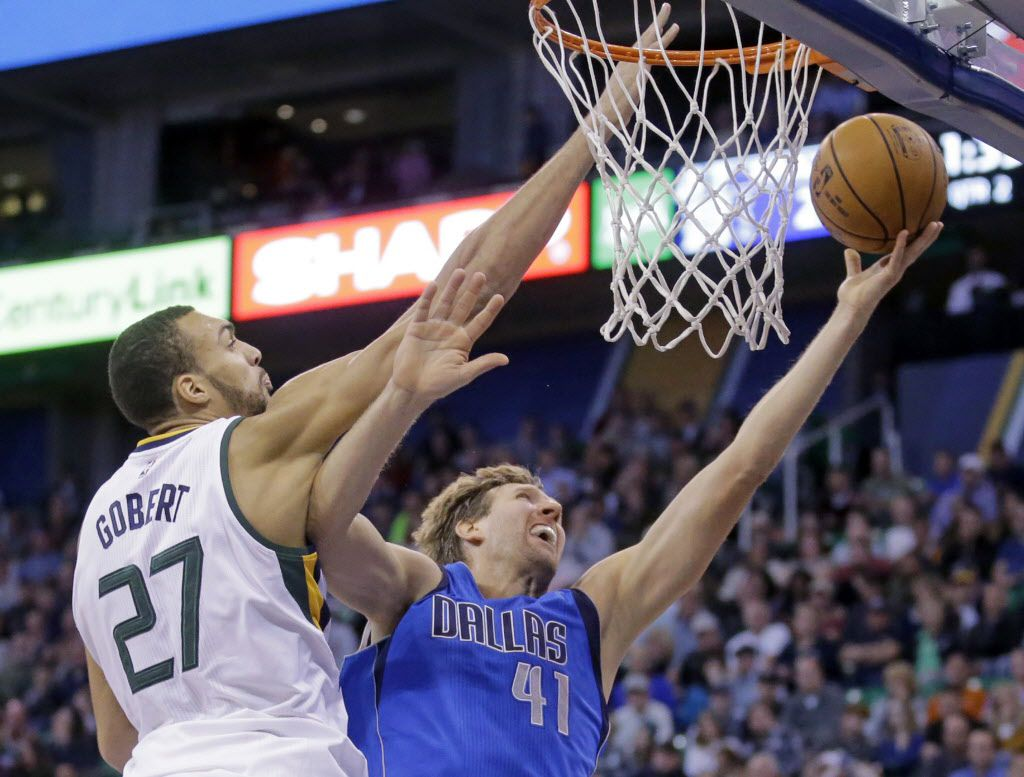 Dallas Mavericks forward Dirk Nowitzki (41) lays the ball up as Utah Jazz center Rudy Gobert (27) defends during the second quarter of an NBA basketball game Wednesday, Nov. 2, 2016, in Salt Lake City. (AP Photo/Rick Bowmer)