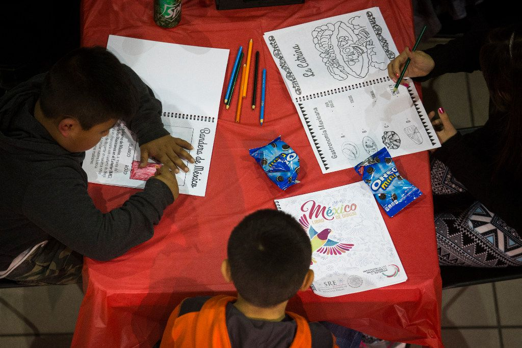 Children color in another room as their parents attend a community meeting on possible deportations at the Consulate General of Mexico on Thursday, Feb. 16, 2017, in Dallas. (Smiley N. Pool/The Dallas Morning News)