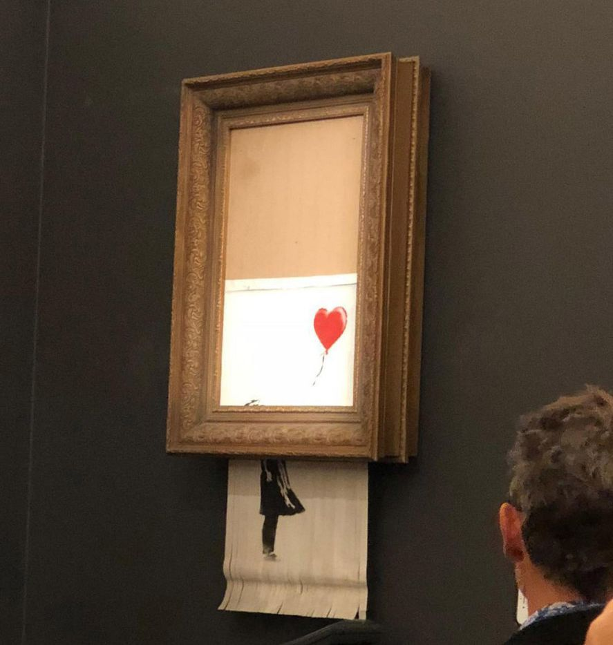 In a photo provided by Sotheby's, the moment when Banksy's Girl With Balloon was destroyed by a remote-control shredder, at Sotheby's. The British street artist Banksy appeared to pull off one of his most spectacular pranks
