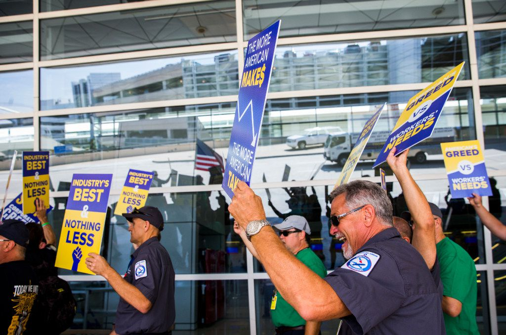 American Airlines employees protested the lack of a new contract for baggage carriers, mechanics and other staff on July 26, 2017, outside Terminal D at DFW International Airport.