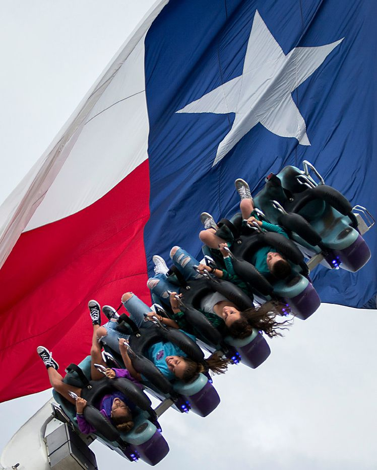 Fairgoers ride on the Space Roller ride during the State Fair of Texas at Fair Park on Friday, Oct. 14, 2016, in Dallas. (Smiley N. Pool/The Dallas Morning News)