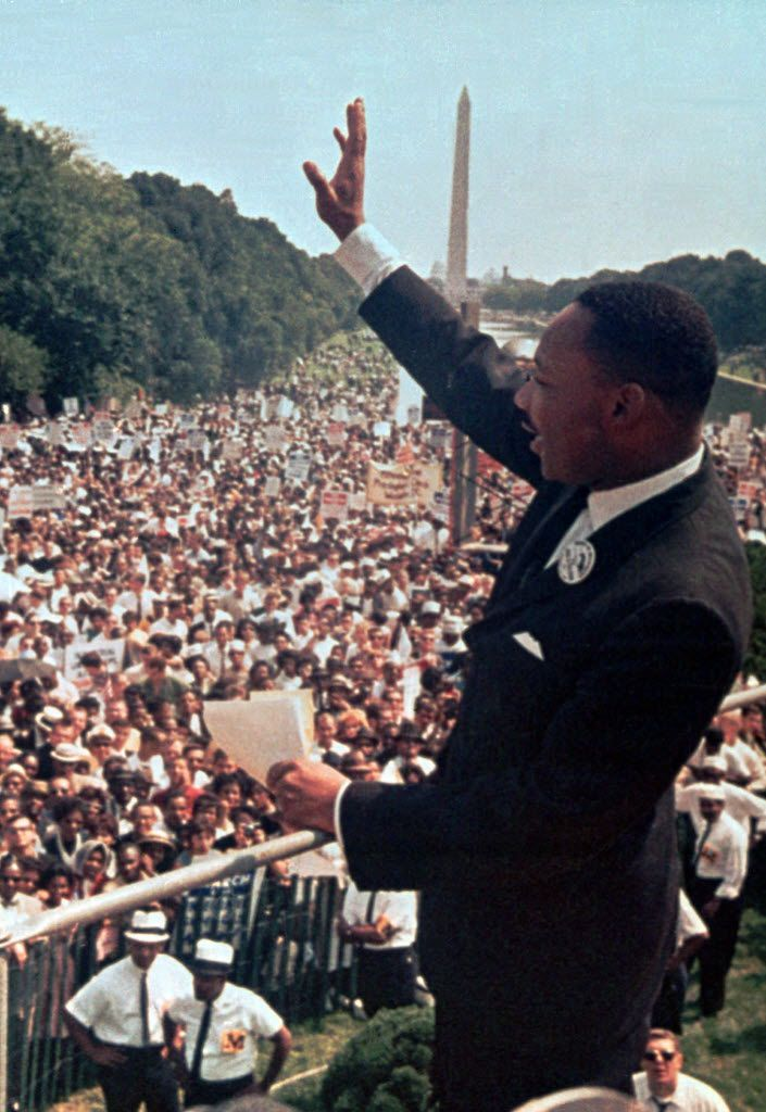 """In this Aug. 28, 1963, file photo, the Rev. Martin Luther King Jr. waves to the crowd at the Lincoln Memorial for his """"I Have a Dream"""" speech during the March on Washington. The march was organized to support proposed civil rights legislation and end segregation."""