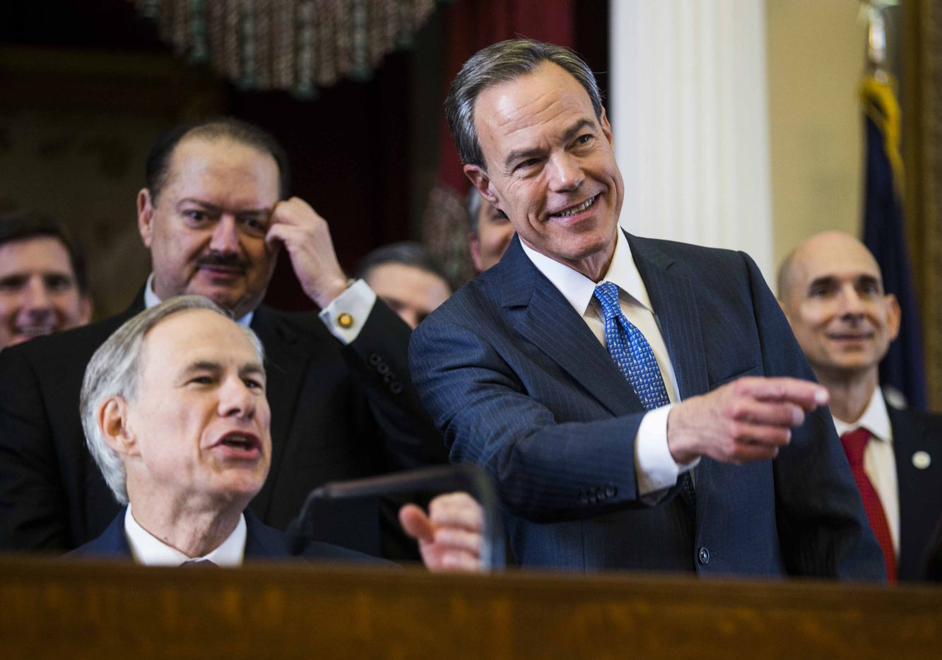 Texas Gov. Greg Abbott and Speaker of the House Joe Straus point to a representative from the podium during the first day of the 85th Texas Legislative Session on Tuesday at the Texas State Capitol in Austin.