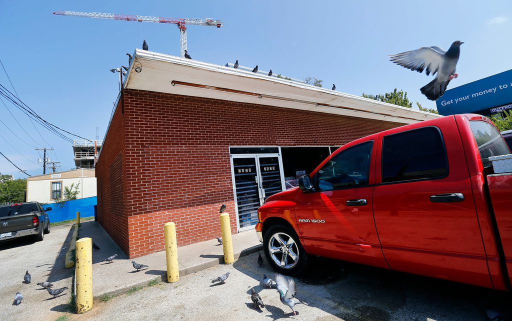 Pigeons roost on the Villasana Food Store owned by Charlie Villasana, a longtime Little Mexico resident who has put off selling his property in the area, which is worth more than $1.3 million. He is nearly 88 and struggles with deciding what to do with the store.