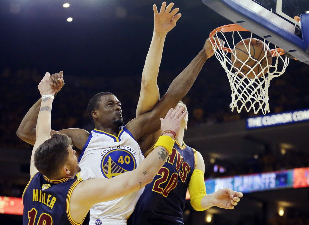 Golden State Warriors forward Harrison Barnes (40) dunks over Cleveland Cavaliers guard Mike Miller, left, and center Timofey Mozgov during the second half of Game 5 of the NBA Finals in Oakland, Calif., on Sunday, June 14, 2015. (AP Photo/Ben Margot) 06152015xSPORTS