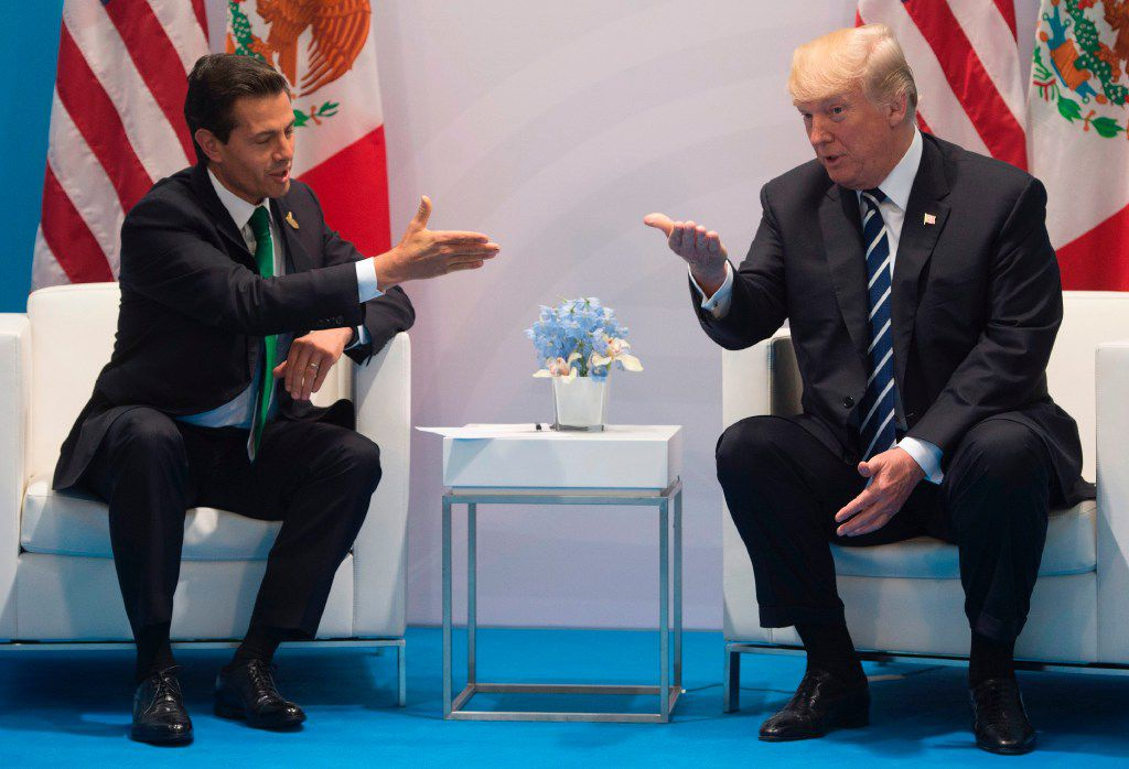 U.S.President Donald Trump and Mexican President Enrique Peña Nieto met at the G20 Summit in Hamburg, Germany, on July 7. (Saul Loeb/Agence France-Presse)