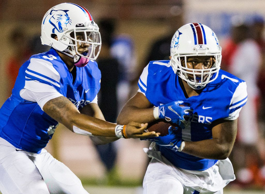 Duncanville quarterback Ja'Quinden Jackson (3) hands off the ball to running back Trysten Smith (1) during the first quarter of a high school football game between Skyline and Duncanville on Friday, October 4, 2019 at Panther Stadium in Duncanville. (Ashley Landis/The Dallas Morning News)