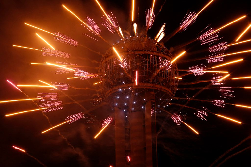 Fireworks fly from Reunion Tower during the New Year's Eve event in Dallas on Dec. 31, 2016.
