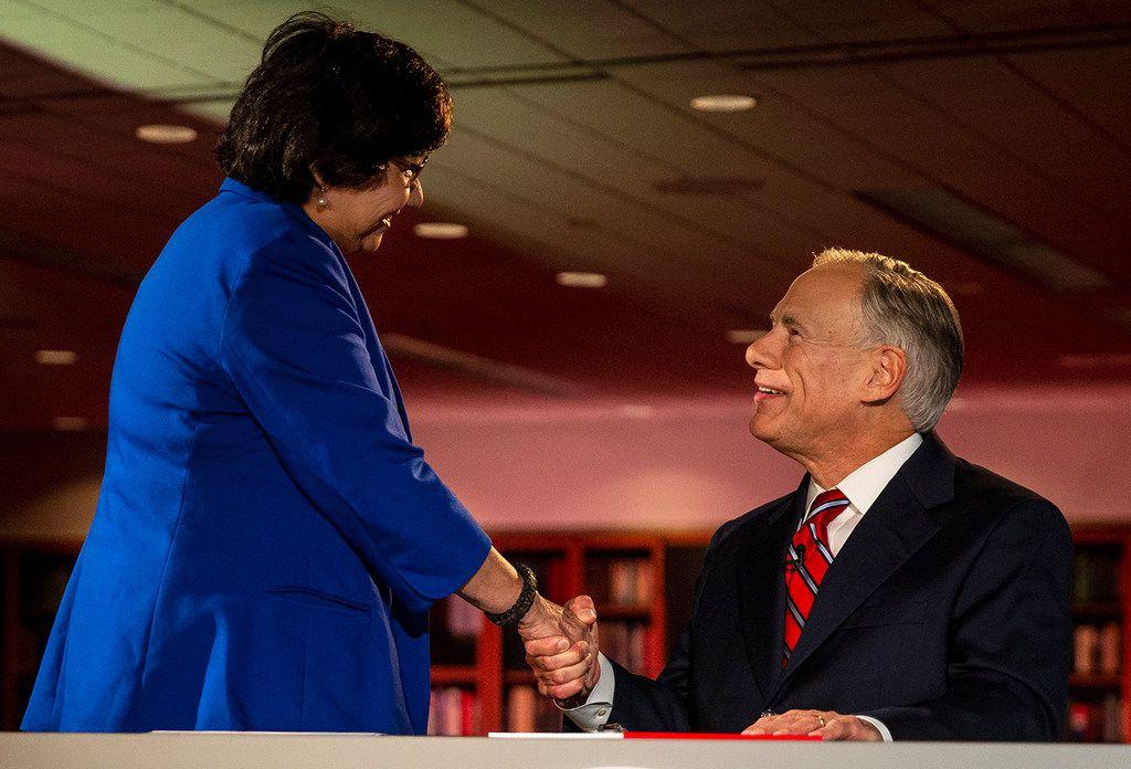 Gov. Greg Abbott and challenger Lupe Valdez shake hands before their debate.