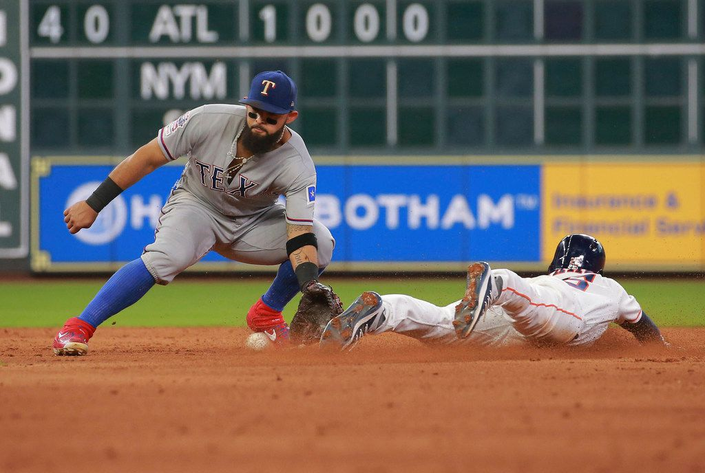 Houston Astros' Myles Straw steals second base ahead of the throw to Texas Rangers Rougned Odor in the sixth inning of a baseball game Saturday, July 20, 2019, in Houston. (AP Photo/Richard Carson)