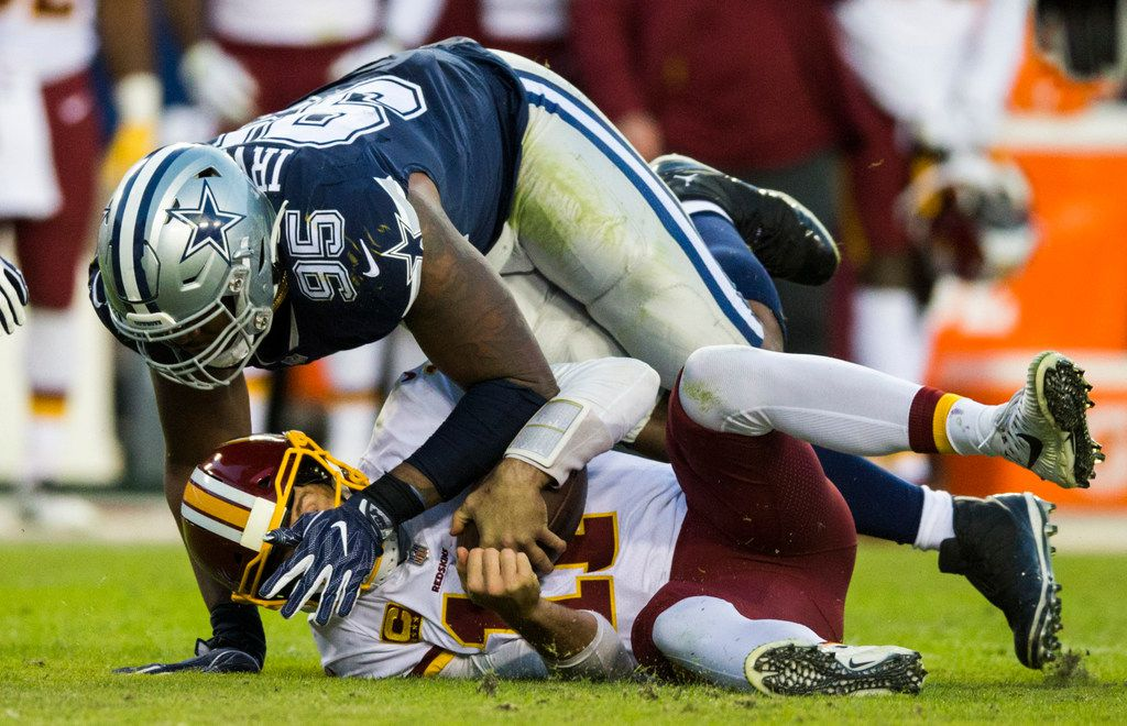 Dallas Cowboys defensive tackle David Irving (95) sacks Washington Redskins quarterback Alex Smith (11) during the third quarter of an NFL game between the Washington Redskins and the Dallas Cowboys on Sunday, October 21, 2018 in Landover, Maryland. (Ashley Landis/The Dallas Morning News)