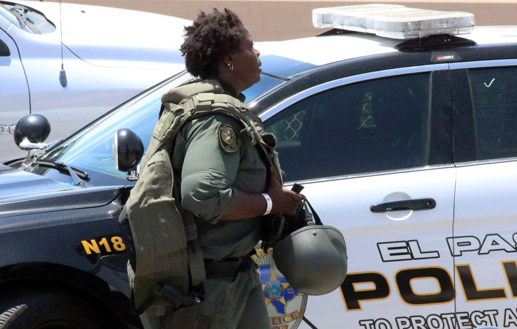 A law enforcement officer walks near the scene of a shooting at a shopping mall in El Paso, Texas, on Saturday, Aug. 3, 2019.   Multiple people were killed and one person was in custody after a shooter went on a rampage at a shopping mall, police in the Texas border town of El Paso said.