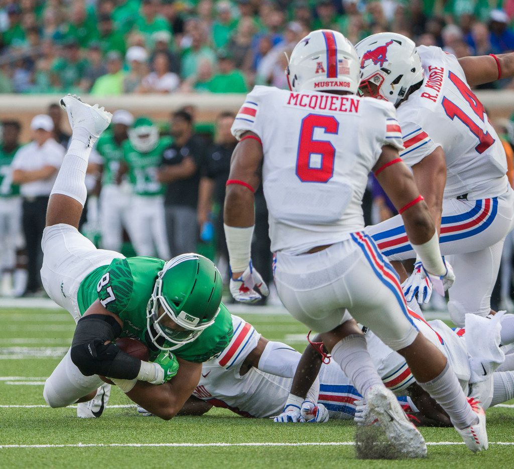 North Texas Mean Green tight end Kelvin Smith (87) is brought down by Southern Methodist Mustangs defense during a game between University of North Texas and Southern Methodist University on Saturday, September 1, 2018 at Apogee Stadium in Denton, Texas. (Ryan Michalesko/The Dallas Morning News)