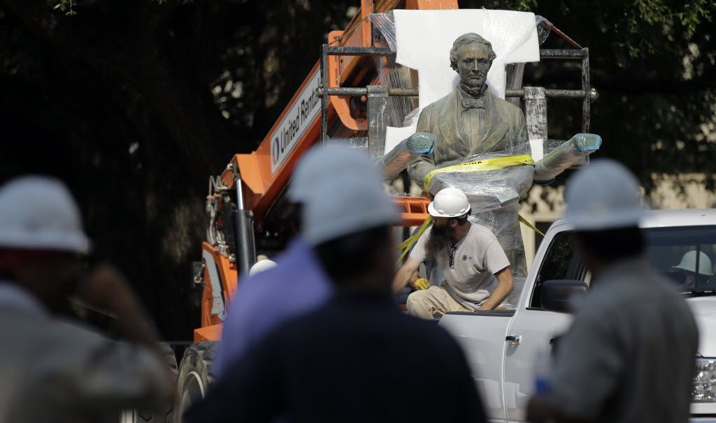 A statue of Confederate President Jefferson Davis is moved from its location in front of the school's main tower the University of Texas campus, Sunday, Aug. 30, 2015, in Austin, Texas. The Davis statue, which has been targeted by vandals and had come under increasing criticism, will be moved and placed in the school's Dolph Briscoe Center for American History as part of an educational display. (AP Photo/Eric Gay) 08312015xPUB