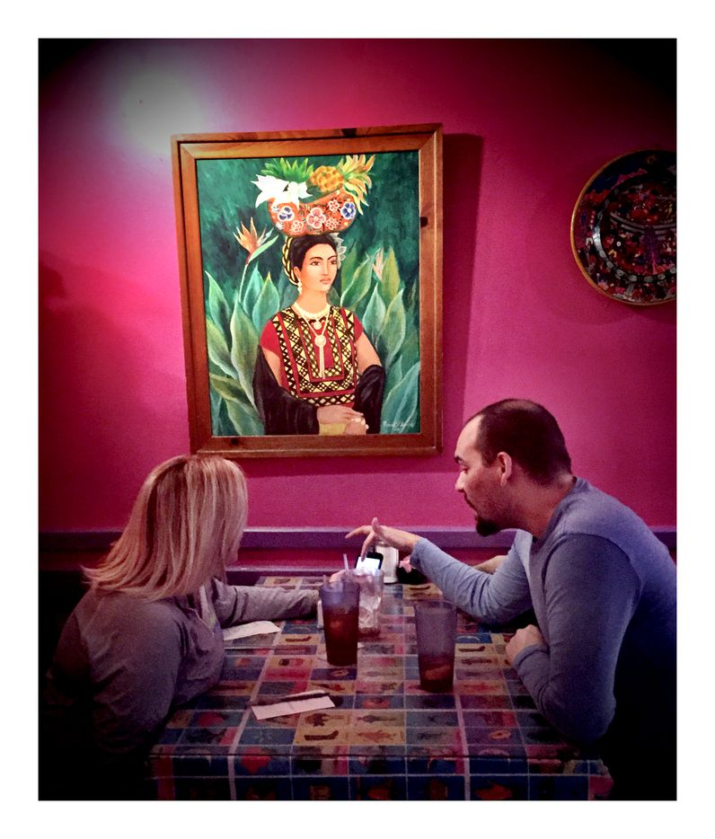 Lisa Garris and CJ Curtsinger enjoy lunch at Mia's on Lemmon Avenue in January 2019, with a portrait of Frida Kahlo for company.