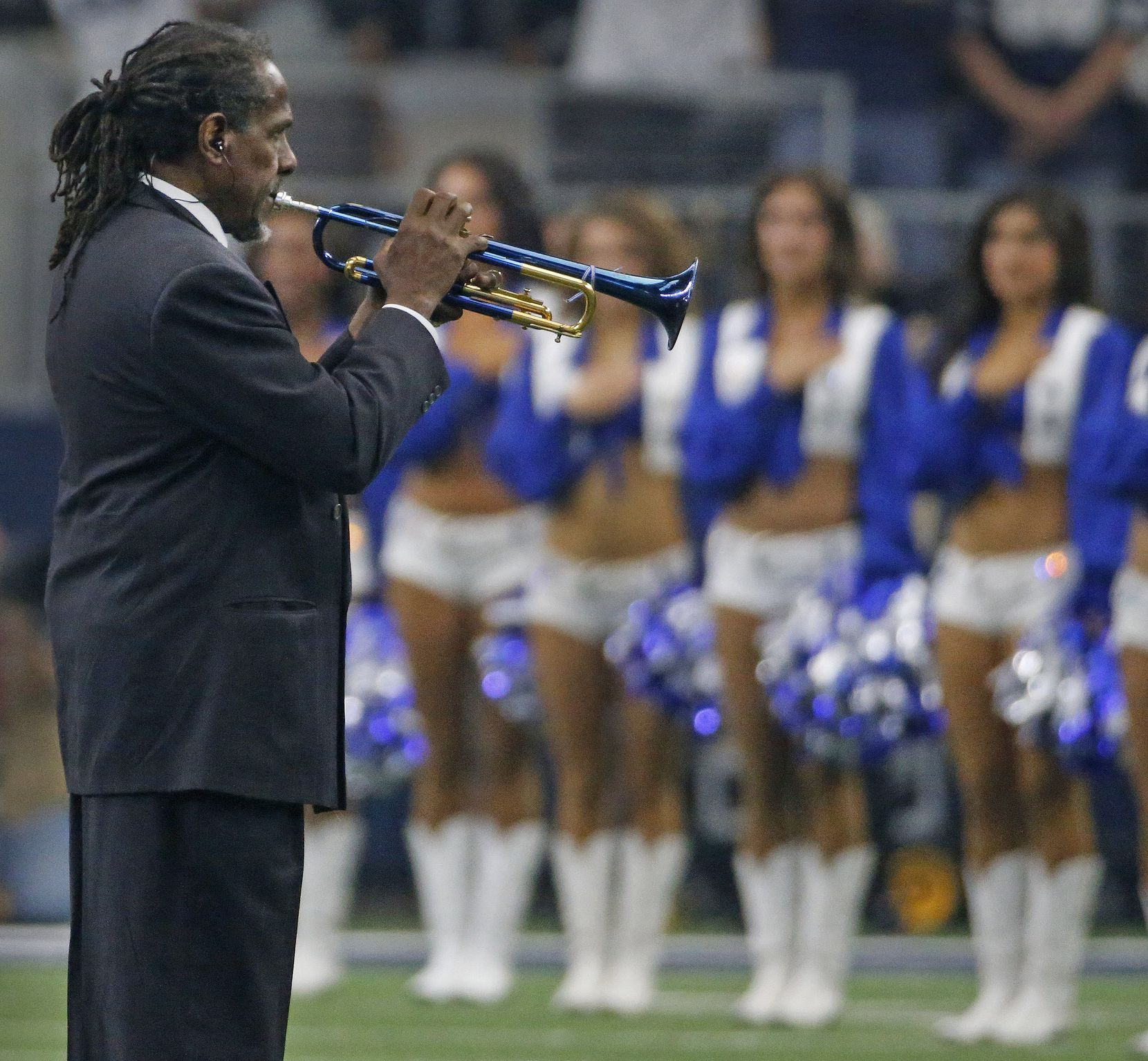 Freddie Jones plays the national anthem on his trumpet before the Los Angeles Rams vs. the Dallas Cowboys NFL football game at AT&T Stadium in Arlington on Sunday, October 1, 2017.