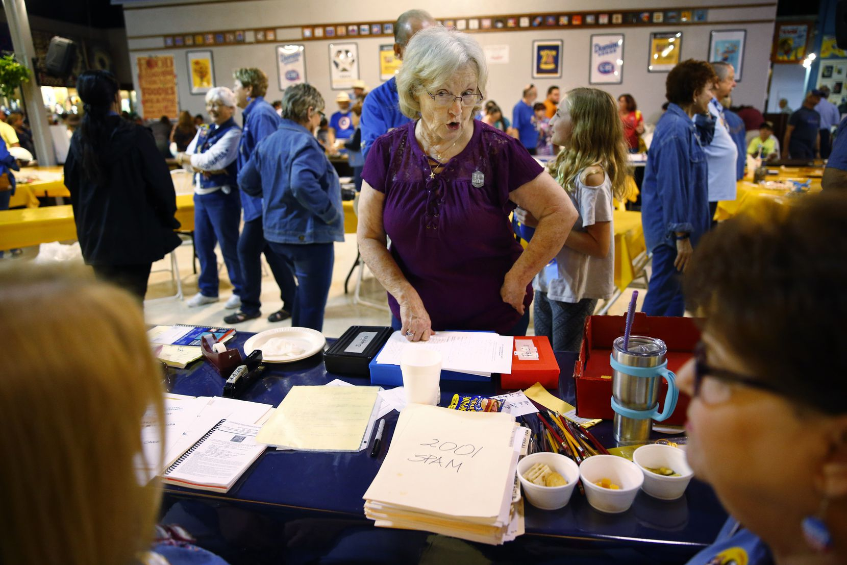Peggy Garmon brags about her granddaughters to administrators of the contest at the State Fair of Texas on Oct. 6.