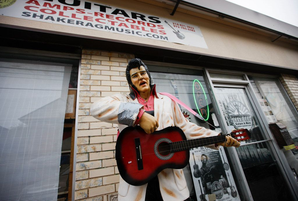 An Elvis statue stands outside Shake Rag when John Gasperik's inside.
