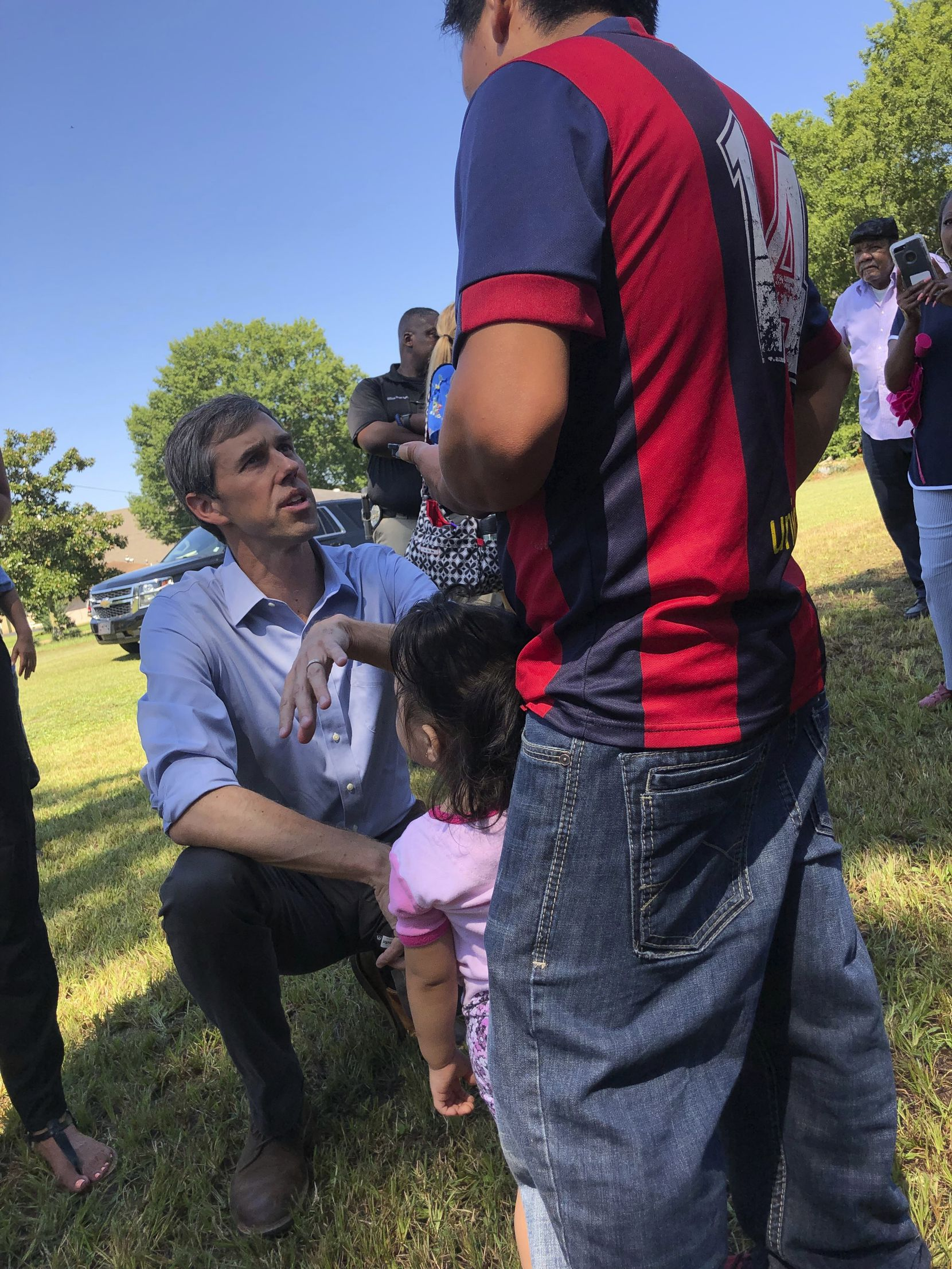 Presidential candidate Beto O'Rourke speaks in Spanish to Guatemalan immigrant Agusto Lopez Coronado in Canton, Miss., on Friday, Aug. 16, 2019. Coronado initially declined to give his name to journalists because of fears of repercussions days after the immigration raids at chicken processing plants in Mississippi. Coronado later identified himself in an interview, saying his wife was arrested in an immigration raid Aug. 7, 2019, while she was working at a chicken processing plant in Canton and she is jailed in Louisiana while he remains in Canton caring for their three children.