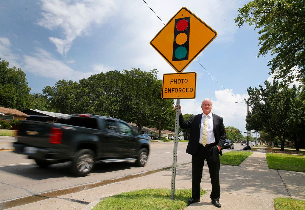Attorneys Russell Bowman (pictured) and Scott Stewart are challenging the City of Irving and several other cities in the state on the use of red light cameras on the grounds of constitutionality and violation of state law. The city of Irving uses a set of cameras with a sign warning drivers of their use at O'Connor Road and Lane Street in Irving.