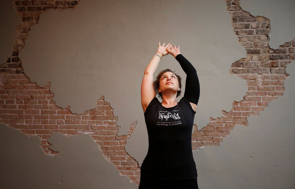 Brandie Sellers stretches prior to teaching a Sunday morning yoga class at Yoga Balance Studio in downtown McKinney.