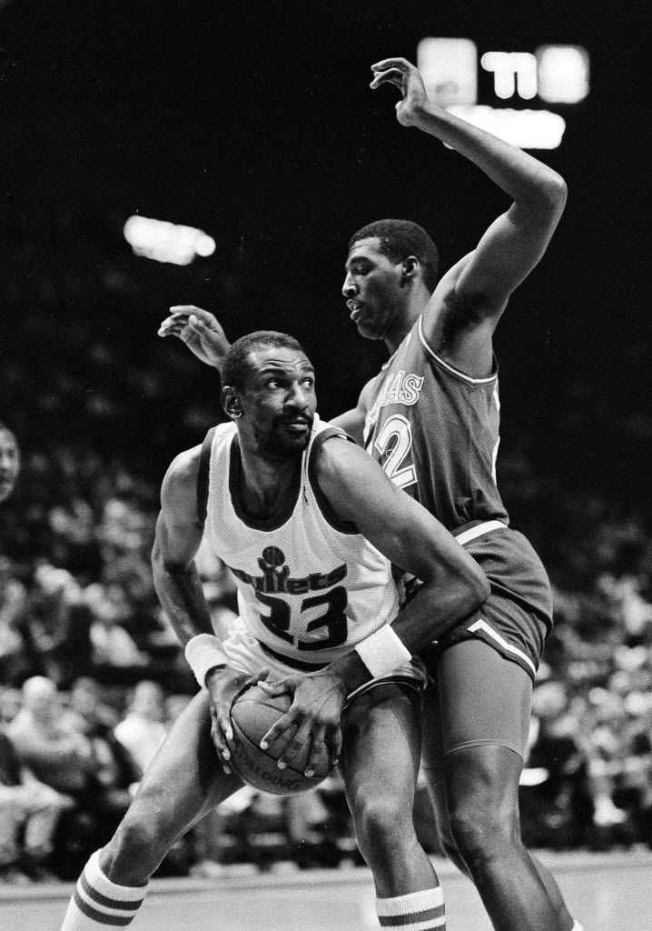 In this April 1, 1988, file photo, Washington Bullets' Charles Jones, left, drives for the basket against Dallas Mavericks' Roy Tarpley during an NBA basketball game in Landover, Md. (AP Photo/File)