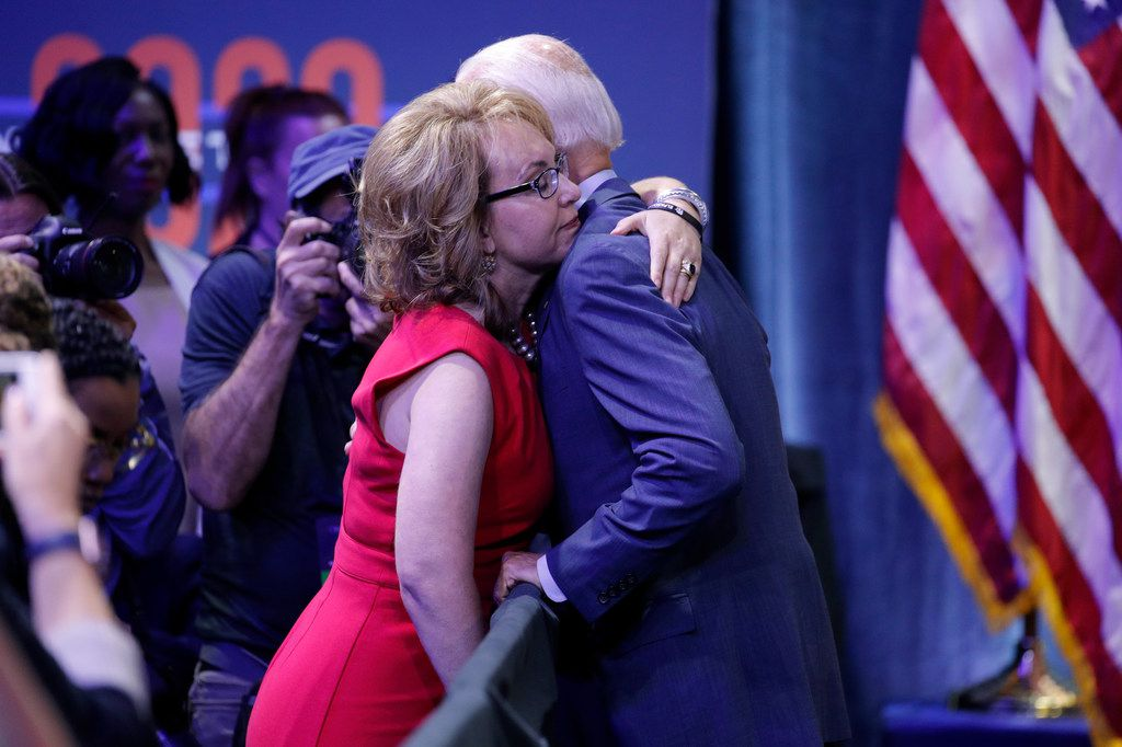 Former vice president and Democratic presidential candidate Joe Biden hugs former Rep. Gabby Giffords during a gun safety forum in Las Vegas.