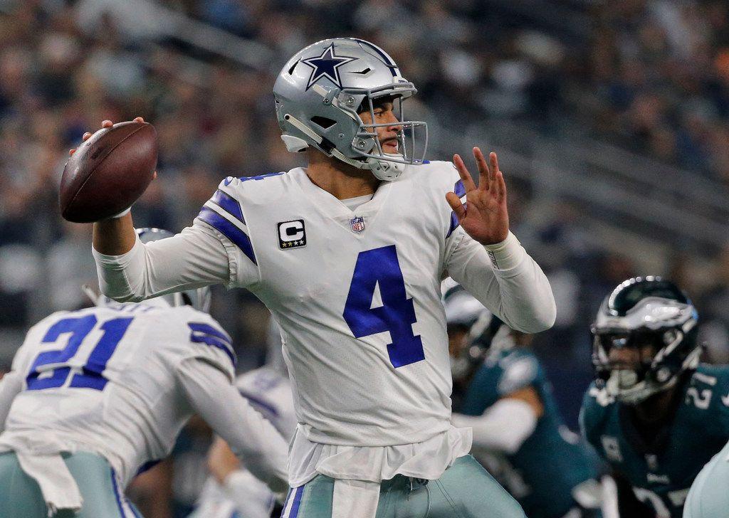 Dallas Cowboys quarterback Dak Prescott (4) throws a pass during the Philadelphia Eagles vs. the Dallas Cowboys NFL football game at AT&T Stadium in Arlington, Texas on Sunday, December 9, 2018. (Louis DeLuca/The Dallas Morning News)