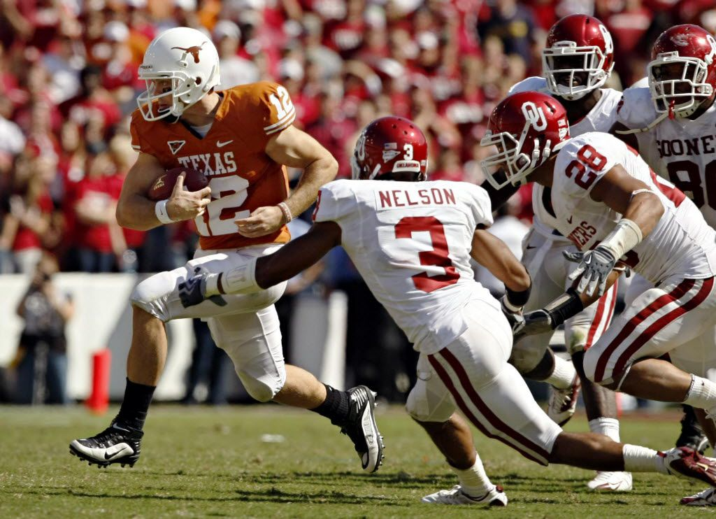 ** NCAA ** COTTON BOWL ** RED RIVER RIVALRY ** TEXAS LONGHORNS vs OKLAHOMA SOONERS ** 10/17/2009 -- Texas Longhorns quarterback Colt McCoy (12) breaks away from Oklahoma Sooners defenders Jonathan Nelson (3) and Travis Lewis on a carry in the second half of Texas' 16-13 win Saturday, October 17, 2009 at the Cotton Bowl in Dallas. (G.J. McCarthy/The Dallas Morning News)The Dallas morning news
